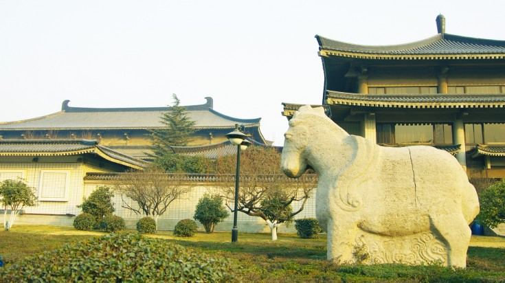 A view of traditional house complex with a horse sculpture in its yard