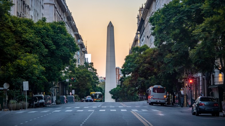 A street lane lined with green trees and a obelisk tower at the end is an iconic site in Buenos Aires — an easy inclusion in any Argentina itinerary