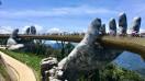 Visit Da Nang and walk across the Golden bridge in Ba Na Hills.