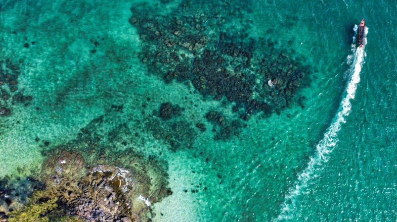 An aerial view of the reefs in a turquoise transparent water at Koh Rong