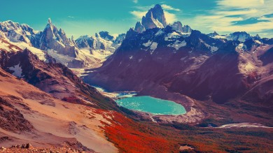 Snow covered mountains with a turquoise lake at the bottom — a sight that should easily be included on any 3-week tour in Argentina