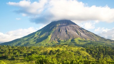 A view of Arenal Volcano in Costa Rica, an active volcano popular for many things to do in Costa Rica like hiking, hot springs and mud baths.