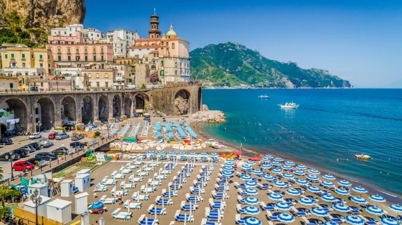 Atrani beach in Campania is beautifully nestled between the steep cliffs of Tyrrhenian sea and a must visit if you have 2 weeks in Italy.