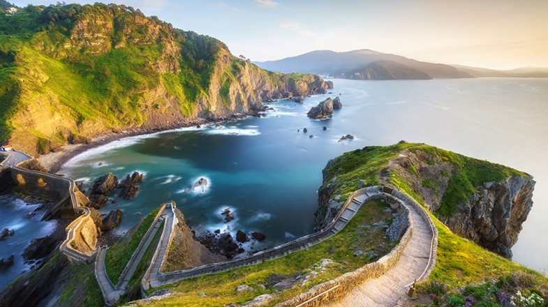 Visit San Juan de Gaztelugatxe — the rocky islet can be reached via causeway from the mainland and is topped by a 10th century chapel.