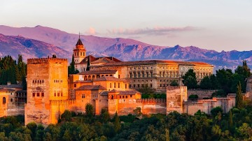 If you're in Spain, you simply must visit Alhambra, a sprawling hilltop fortress and palace complex in Granada.