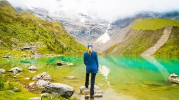A woman enjoying the scenery of Humantay Lake in Peru