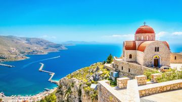 A holiday in Greece includes visit to ancient ruins, white sandy beaches and taste of delicious Mediterranean cuisine.