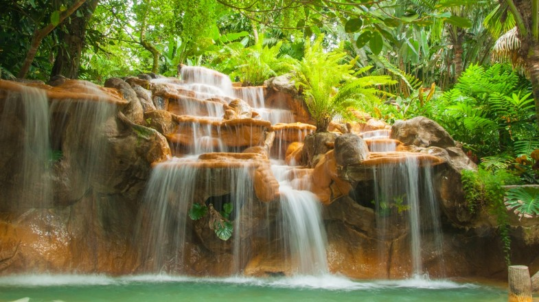Soak in the natural hot springs near Arenal Volcano