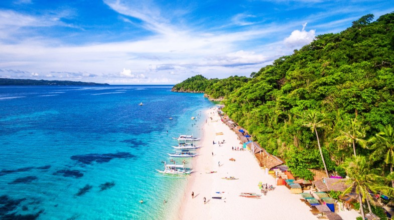 Puka beach has a serene sandy strip to lay back and relax