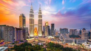 Things to do in Malaysia include lounging on tropical beaches, trekking through national parks and having a 3-course meal for around USD 5*.