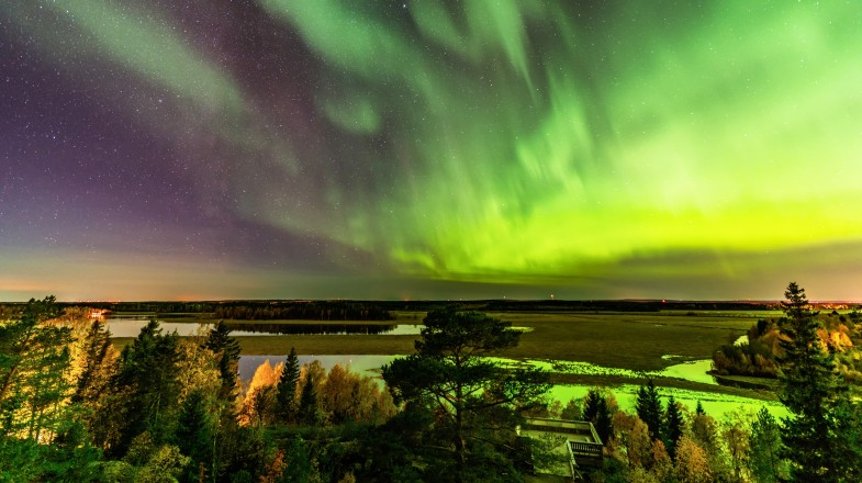 Green lights in the night sky known as northern lights in Scandinavia