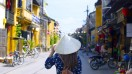 One of the best places to visit in Vietnam includes Hoi An, a well-preserved town by the river.
