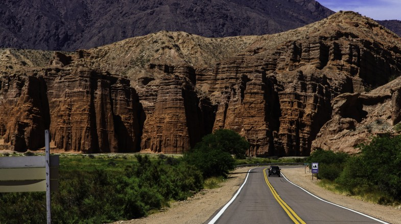 Quebrada de Cafayate is a deep canyon framed by extraordinary rock walls showcasing layers of stunning colors, from deep red to vivid green to cobalt blue.