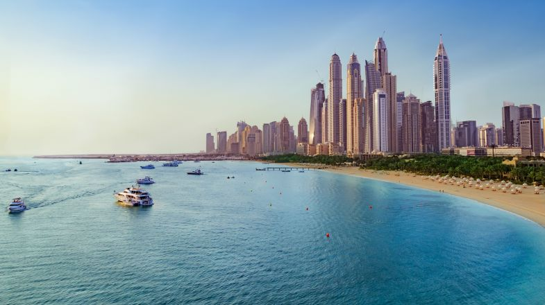 Beach and skyline view of Dubai Marina, UAE