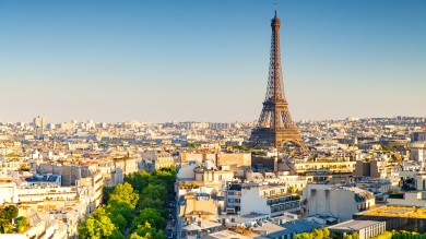 The Eiffel Tower in Paris, France, rises above the city and creates an iconic skyline view.