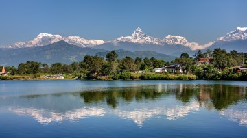 snow-capped mountains, green hills and a lake in Pokhara, Nepal