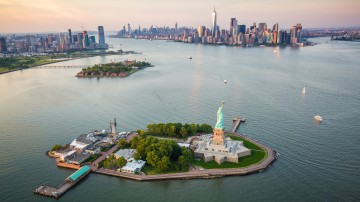 An aerial view of New York City and the Statue of Liberty. These are two of the best things to do in the USA.