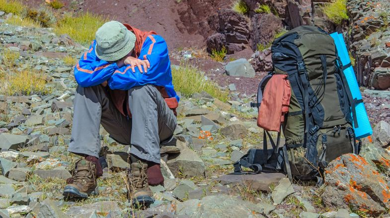 Trekker resting due to altitude illness in the Himalayan region of Nepal