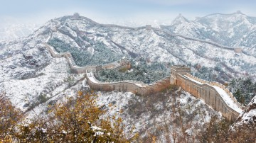 Great wall of China and surrounding covered in snow during winter in China