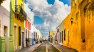 Colorful houses line up on stone paved streets