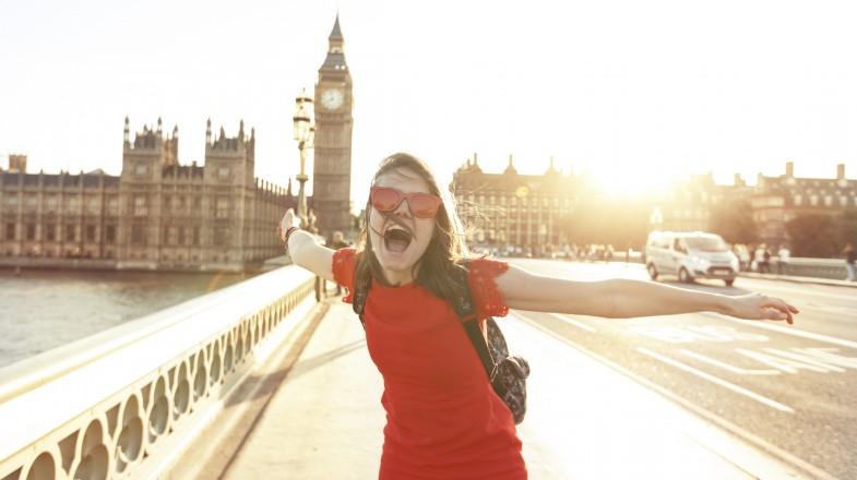 Woman having fun at sunset
