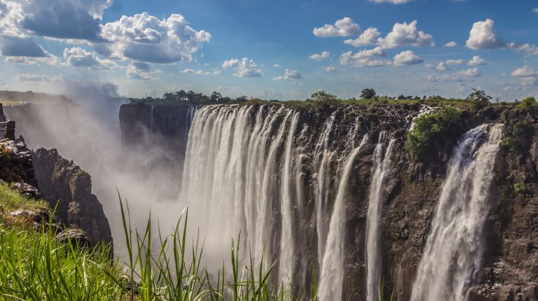 A trip to Zambia will open you to untouched wilderness and unparalleled natural beauty, including Victoria Falls.