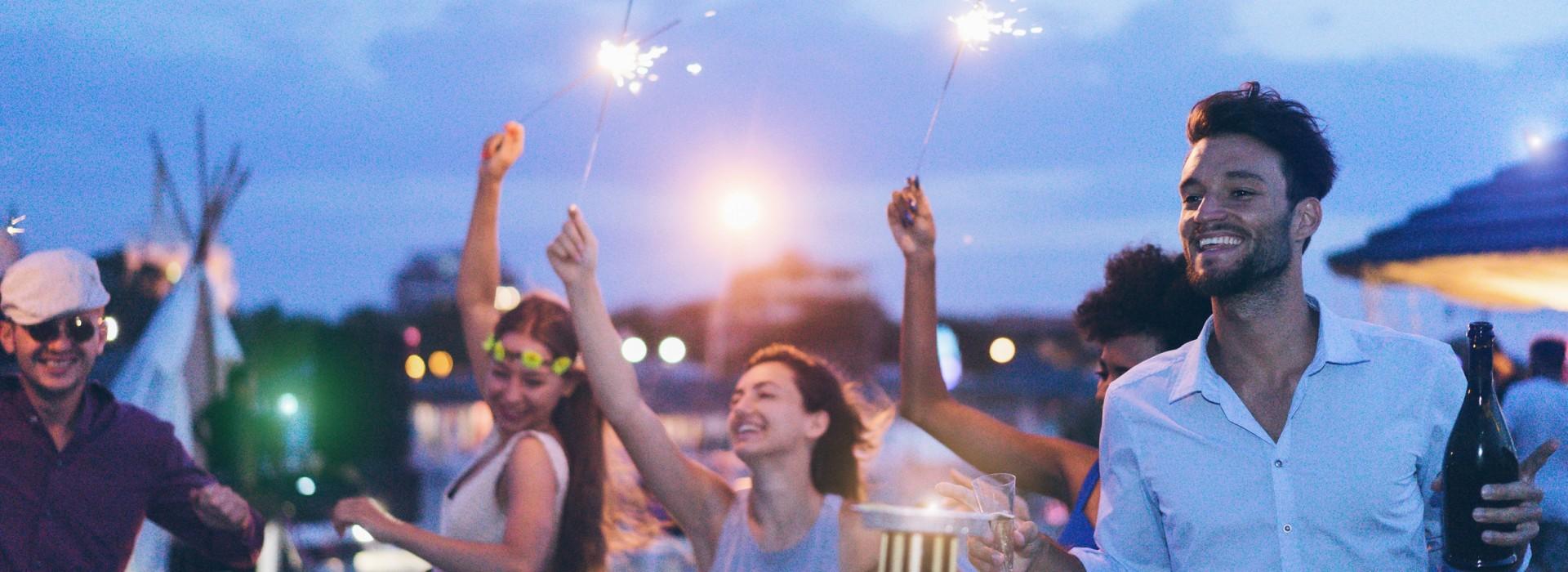 A group of friends enjoying evening beach party
