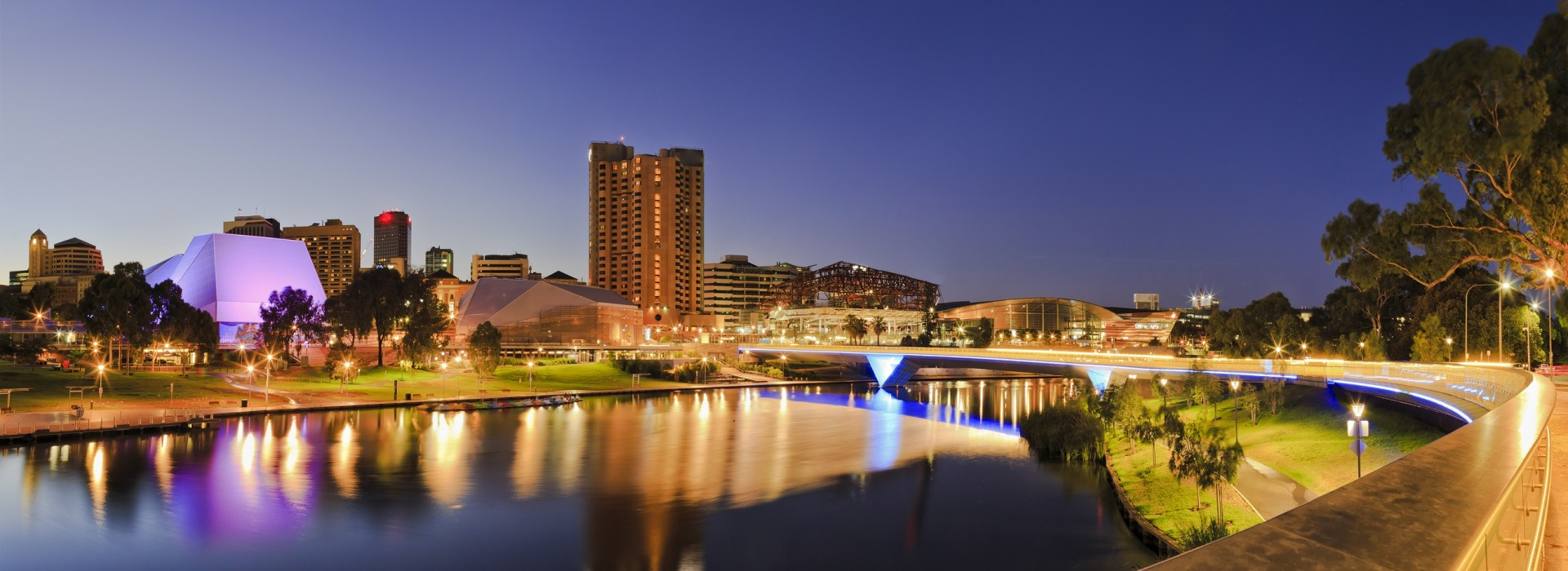 The city of Adelaide in Australia lights up at dusk.