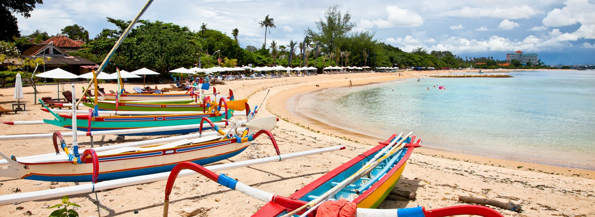 Traditional fishing boats lined up in Sanur's beach