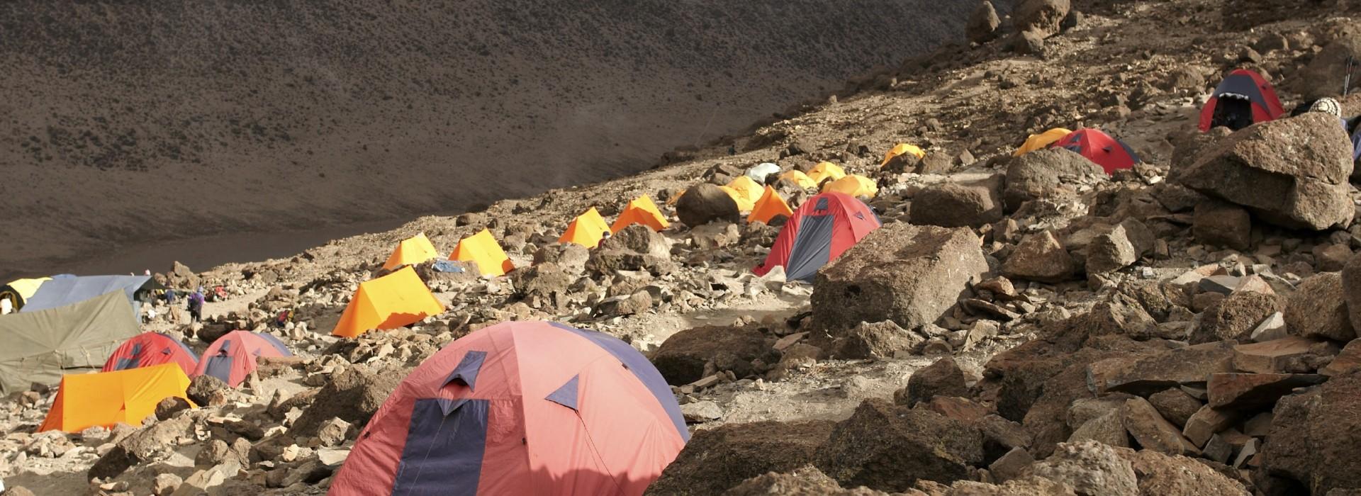 Trekkers passing climbing Mount Kilimanjaro through the Machame Route