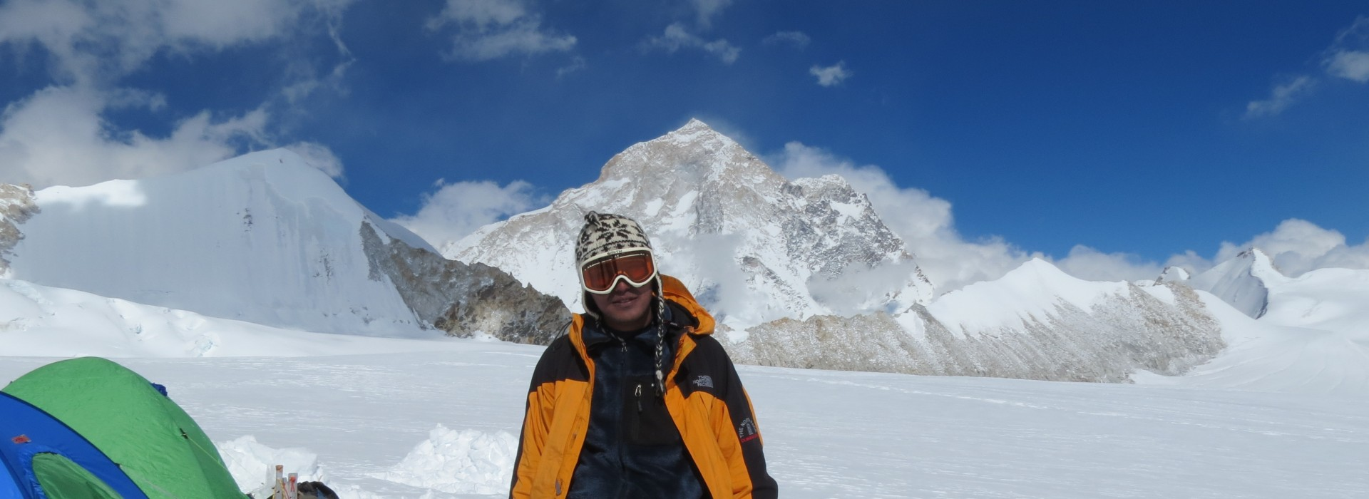 A trekker standing on the Makalu Base Camp Trek, with Mt Makalu in the background
