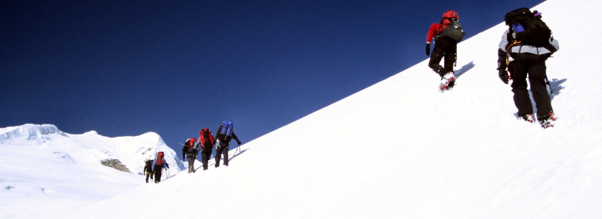A group of climbers climbing Mera Peak