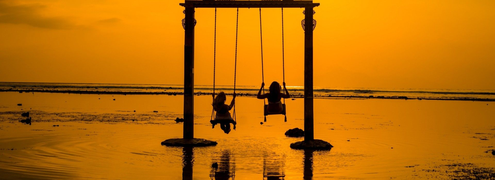 Swinging as the sun sets on one of the Gili Islands.