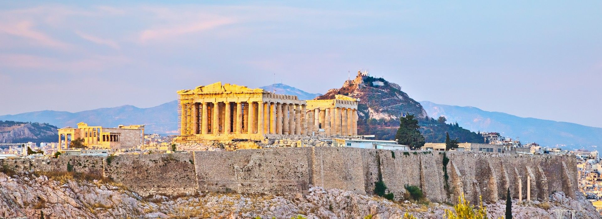 The Acropolis of Athens, an ancient citadel located on a rocky outcrop above the city of Athens