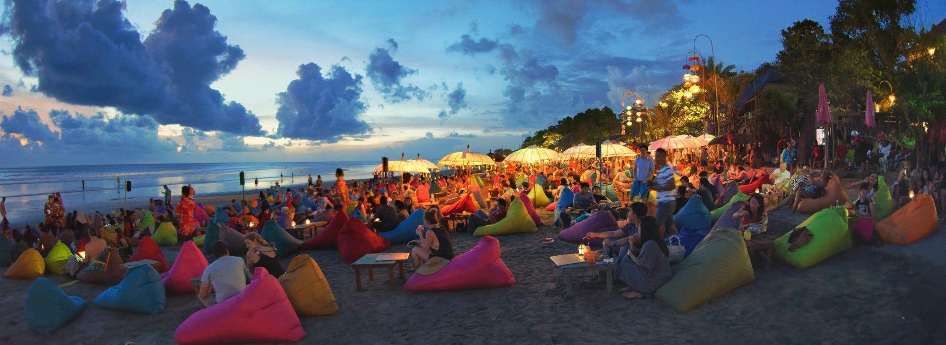 Tourists enjoy the sunset at the beaches of Seminyak