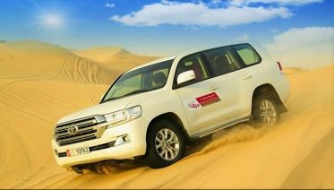 Abu Dhabi Desert Safari with Dune Bashing & BBQ Dinner