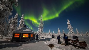 Northern Lights Hunting on Snowmobile in Lapland