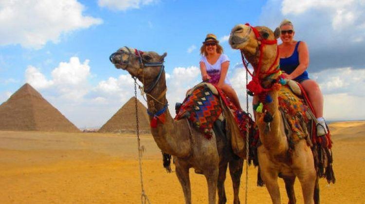 Camel ride around the pyramids in safari trip